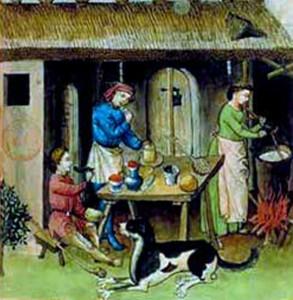 Scène de cuisine au Moyen-Age. Le feu et la cuisson se font à l'extérieur. On peut distinguer un système de poutres croisées au-dessus du feu pour suspendre la marmite.